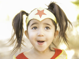 Photo of little girl dressed as Wonder Woman