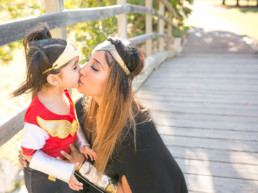 Photo of mom and daughter both dressed as Wonder Woman