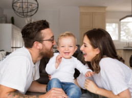 Photo of young family laughing
